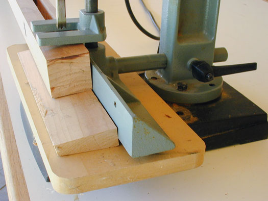 To make an angled mortise, support your workpiece at an angle and cut as usual.