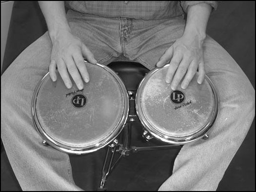 Traditional playing technique for the bongos.