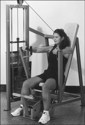 The vertical chest-press machine is an alternative to the dumbbell chest press. [Credit: Photograph
