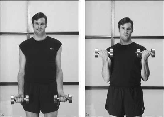 Keep your elbows close to your body while performing the dumbbell biceps curl. [Credit: Photograph