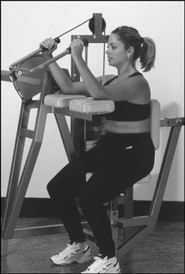 Use the triceps-extension machine at the gym as an alternative to the triceps kickback. [Credit: Ph
