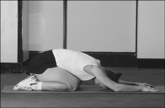 The child's pose in yoga. [Credit: Photograph by Sunstreak Productions, Inc.]