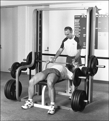 Using barbells to perform a bench press. [Credit: Photograph by Sunstreak Productions, Inc.]