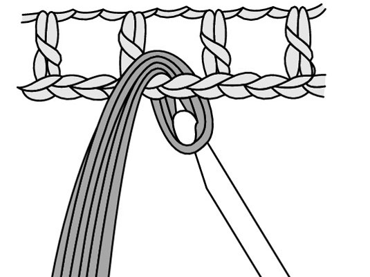 Draw the loop through the stitch that you're attaching the fringe to.