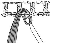 Drawing the loop through the stitch that you're attaching the fringe to.