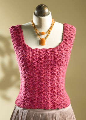 A pink tank top on a mannequin.