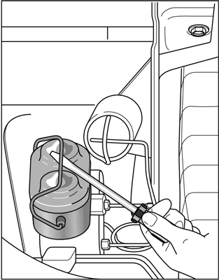 Release the lid of a metal master cylinder with a screwdriver.