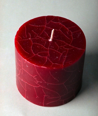 Create cracks in your candle by overdipping and freezing it several times.