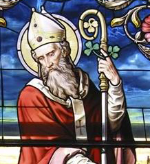 A stained glass portrait of St. Patrick.