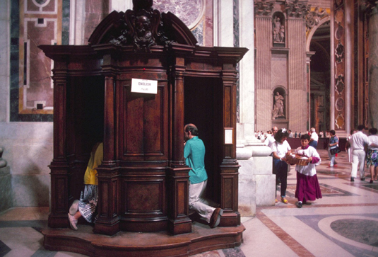 Going to confession may involve kneeling in a confessional and seeing the priest through a screen.