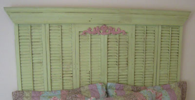 Use salvaged shutters to create a cottage-style headboard.