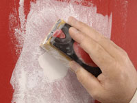 Use a sanding block to smooth the patch.