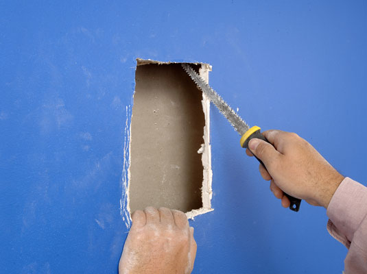 how to fix large holes in drywall with a patch dummies. Black Bedroom Furniture Sets. Home Design Ideas