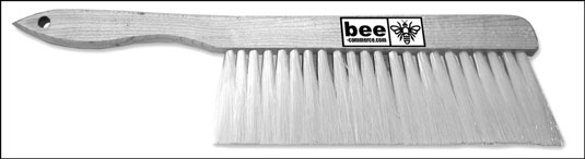 Use a soft bee brush to gently remove bees from frames and clothing.