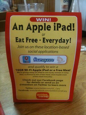 A table tent at the Golden Corral restaurant chain encourages customers to check in to win an iPad