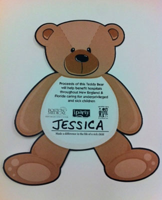 A charitable campaign flyer in the shape of a teddy bear.