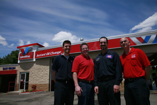 Employees of an Valvoline Instant Oil Change station.