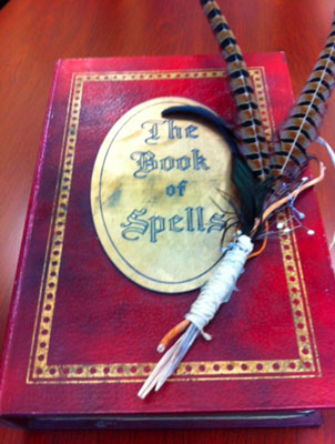 A Halloween event proposal pitch presented as a book of spells.