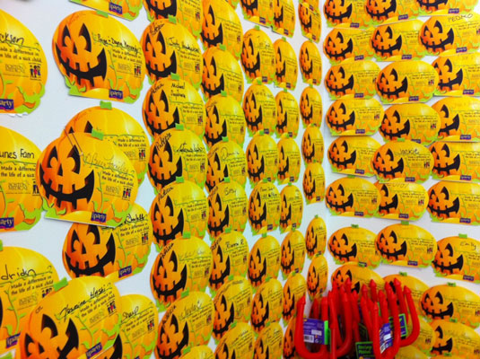 A wall covered in jack-o'-lantern pinups.