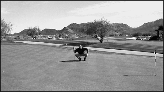 Viewing a putt from the side can help you judge distance and speed.