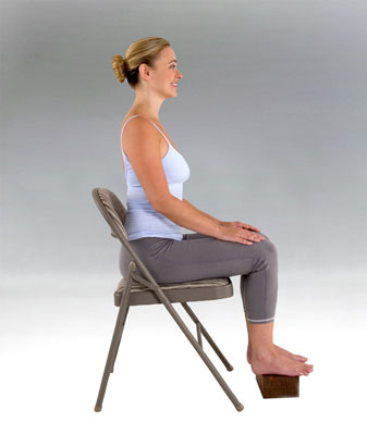 A woman sitting with perfect posture.