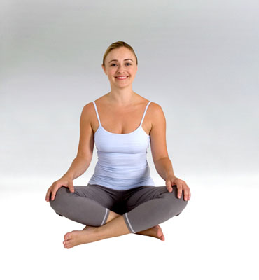 A woman sitting in the easy posture.