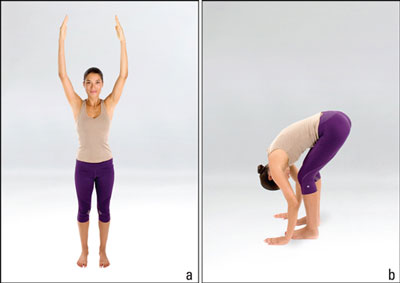 Woman performs the forward bend.