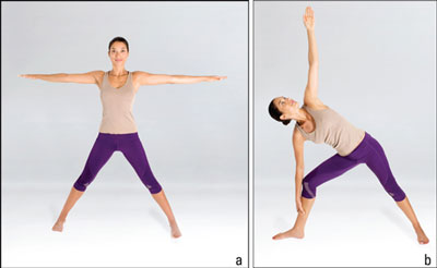 Woman in the yoga triangle position.