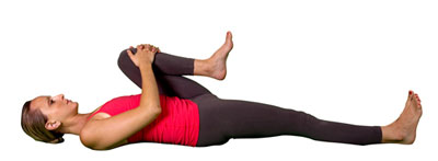 Woman photographed in the knee-to-chest posture.
