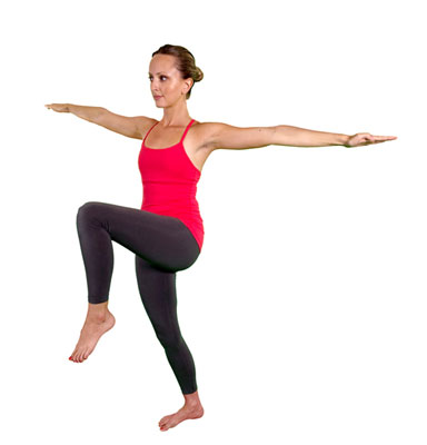 Woman does the Karate Kid posture.