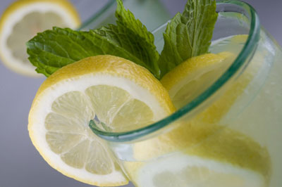 Citrus wedges and fresh mint sprigs adorn this beverage. [Credit: Focal length: 55mm, Shutter speed