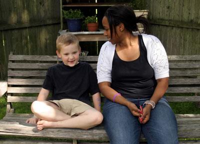 Young woman babysitting a boy.