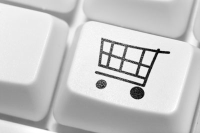 A shopping cart keyboard button.