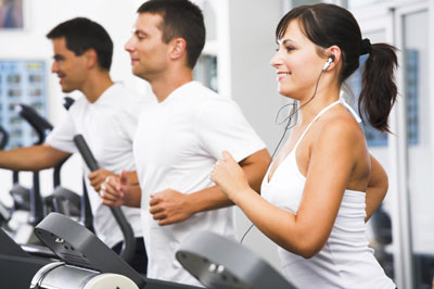 Three people exercising in the gym.