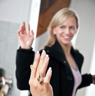 Woman says goodbye to an acquaintance.