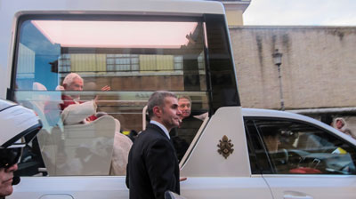 Pope Benedict XVI in the pope mobile.