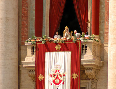 Pope Benedict XVI giving mass from the balcony of St. Peter's Cathedral.