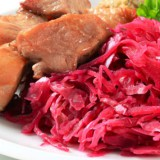 A plate of slow cooked pork and sauerkraut.