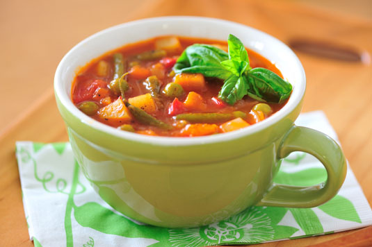 A cup of vegetable soup.