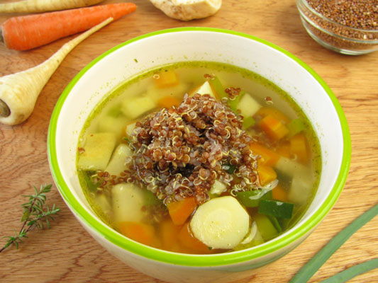 A bowl of vegetable broth with quinoa.