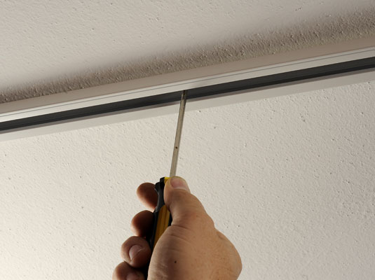 replacing track lighting. securing a track to the ceiling replacing lighting