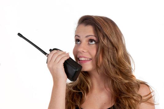 Woman using a walkie talkie.