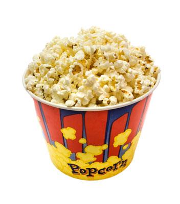 A large tub of popcorn.
