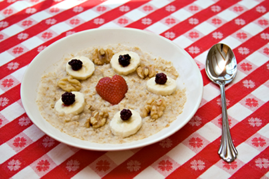 A bowl of strawberries and cream oatmeal.