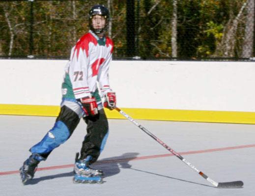 A hockey player skating through a rink.
