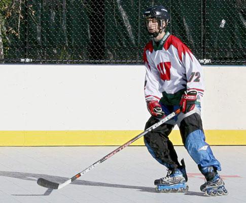 A hockey player in full gear.