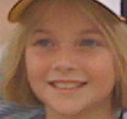 Bitmap image of a girl wearing a baseball cap.