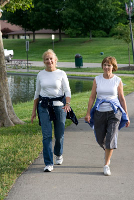 Two women walking on the park.
