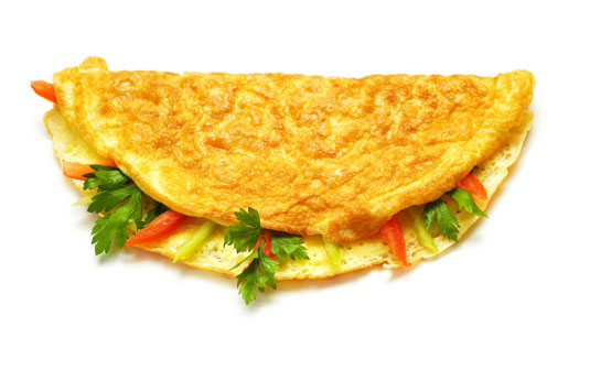 An egg omelette filled with vegetables.