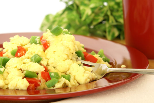 Scrambled eggs with green and red peppers.